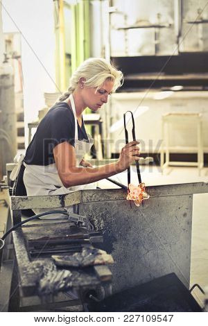Woman shaping craft objects