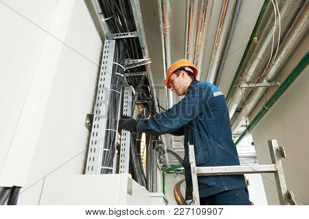 two electrician workers at cabling