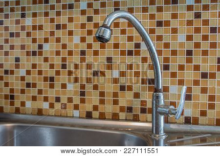 Stainless Sinks With Colorful Mosaic Wall In Kitchen Room