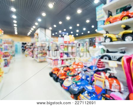 Blurred Of Kids Toy Store Background With Bokhe. Shelves And Aisle Of Kids Toy Shop Interior, Copy S
