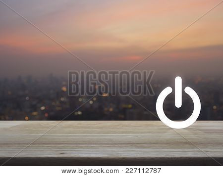 Power Button Icon Over Blur Of Cityscape On Warm Light Sundown, Start Up Business Concept
