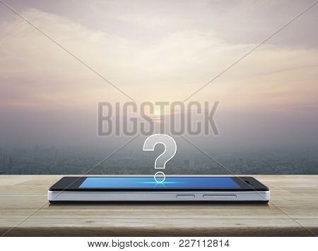 Question Mark Icon On Modern Smart Phone Screen On Wooden Table Over City Tower At Sunset, Vintage S