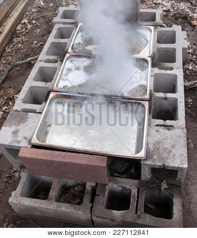 Maple Sap Concentrations Boiling Down To Sweet Homemade Syrup In Backyard Evaporator System Made Of