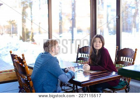 Economist And Engineer On Negotiation In Cozy Coffee House, Old Friends Meet To Discuss Last News. B