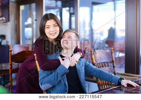 Writer With Smartwatch On Hand Waiting Business Partner In Cafe And Suddenly Meet Former Classmate,