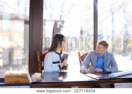 Young Pretty Secretary Refusing Business Boss To Touch Hand At Cafe With Black Document Case On Tabl