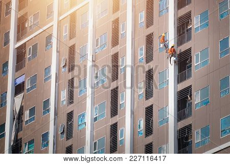 Painter Hanging Painting Color On Building High
