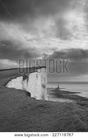 Stunning Black And White Landscape Image Of Beachy Headt Lighthouse On South Downs National Park Dur