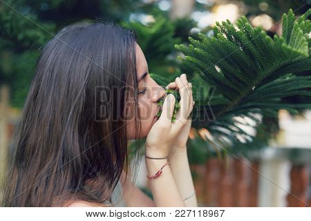 Profile Of Cute Elegant Caucasian Woman With Long Brunette Hair Spending Free Time In Park, Breathin
