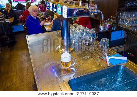 Prague, Czech Republic - December 31, 2017: A Variety Of Beer Taps In A Pub U Parlamentu In Prague,
