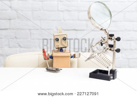 The Robot Holds A Screwdriver And Collects The Microcircuit. Artificial Intelligence