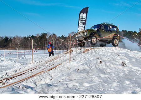 Tomsk, Russia - February 17, 2018: Winter Auto Show Of Jeeps - Ring Race With Obstacles, Off-road Tr