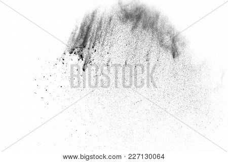 Black Powder Explosion. The Particles Of Charcoal Splatter On White Background. Closeup Of Black Dus