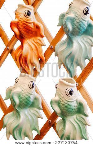 Many Ceramic Fishs Hanging Containing Spanish Moss