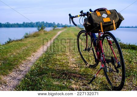 Riding A Bicycle In The Countryside, With Blue Sky And Sunset, River