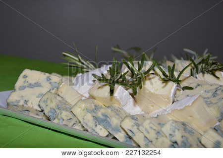 Zoom On Some Cheese Decorated With Rosemary