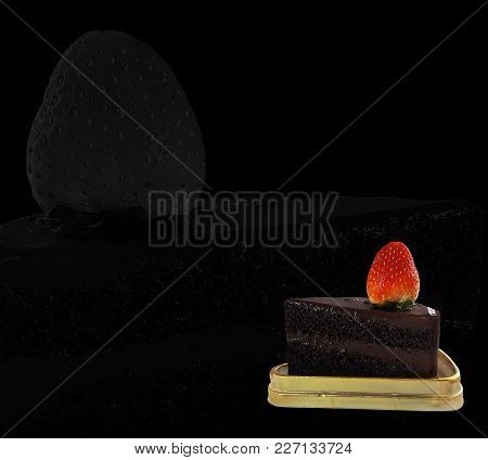 Chocolate Cake And Strawberry Placed On Golden Tray