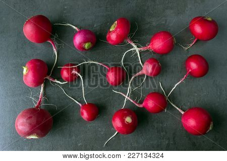Tubers Of Fresh Organic Radishes On A Dark Background. Organic Vegetables.
