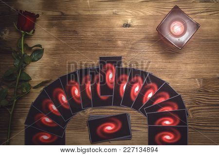 Tarot Cards And Rose Flower On Fortune Teller Desk Table Background. Future Reading. Love Or Romanti