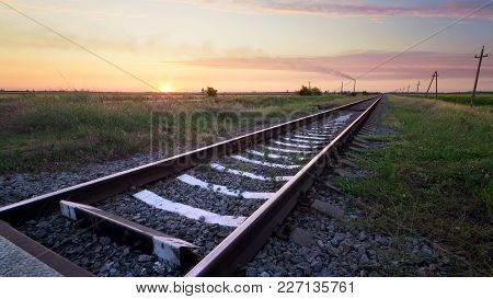 Railway In The Steppe / Photo Right After Sunset Road Leading To The Distance
