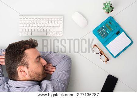 Tired Businessman Employee Sleeping On The Office Desk