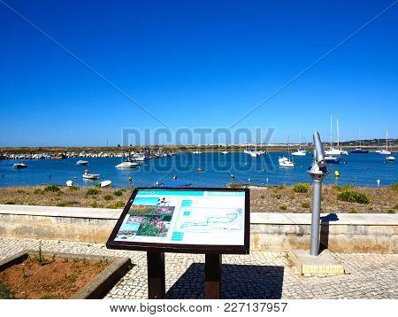 Alvor, Portugal - June 7, 2017 - Fishing Boats And Yachts Moored In The Estuary With A Nature Plan I