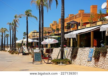 Portimao, Portugal - June 7, 2017 - Row Of Waterfront Restaurants By The Marina And Beach, Portimao,