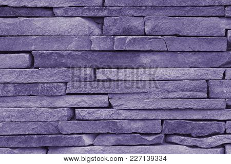 Horizontal Stone Wall Of A Nature Rock - Close Up (photo Is Toned In Ultra Violet)
