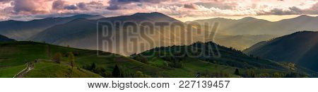 Gorgeous Panorama Of Countryside At Sunset In Springtime. Landscape With Rural Fields On Rolling Hil
