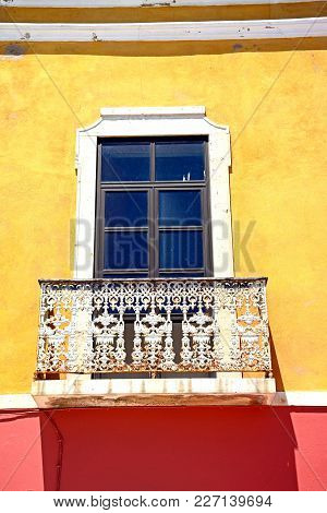 Traditional Portuguese Building With A Wrought Iron Balcony In The Old Town, Portimao, Algarve, Port