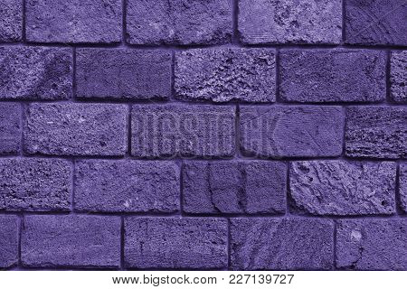 The Texture Of The Stone Wall Of The Porous Surface, Horizontal Shot (photo Is Toned In Ultra Violet