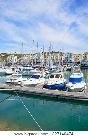 Albufeira, Portugal - June 8, 2017 - Yachts Moored In The Marina With Apartments And Waterfront Busi