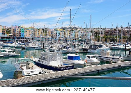 Albufeira, Portugal - June 8, 2017 - Yachts And Boats Moored In The Marina With Apartments And Water