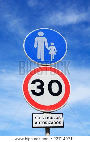 Thirty Kilometre Speed Limit Sign And Pedestrian Sign, Albufeira, Algarve, Portugal, Europe.