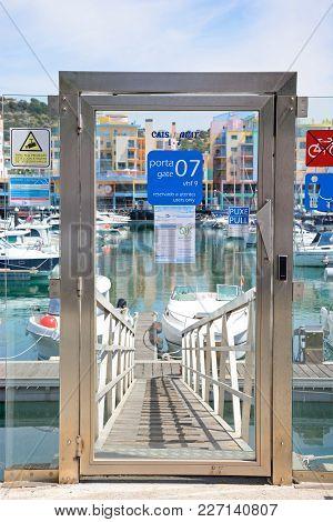 Albufeira, Portugal - June 8, 2017 - Glass Security Door To The Marina Moorings Area, Albufeira, Alg