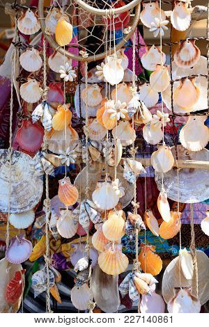Various Stringed Shell Ornaments Hanging In The Marina Area, Albufeira, Algarve, Portugal, Europe.