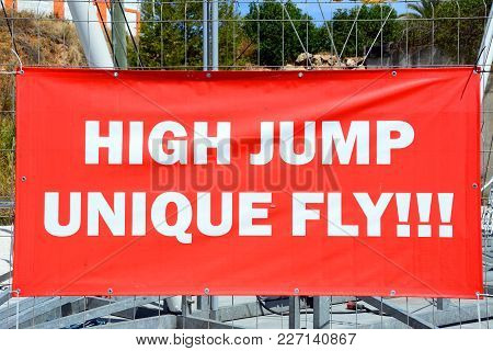 Red High Jump Sign In The Marina Area, Albufeira, Algarve, Portugal, Europe.