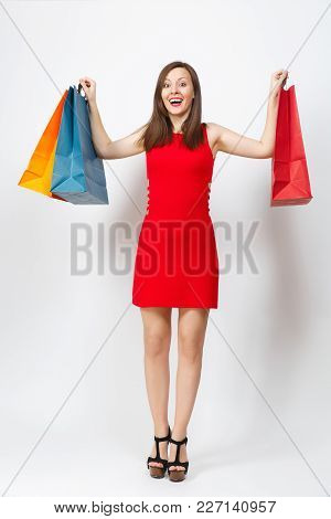 Full Length Of Attractive Glamour Caucasian Young Brown-hair Woman In Red Dress Holding Multi Colore