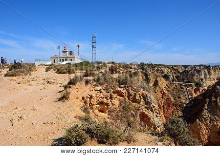 Ponta Da Piedade - June 8 2017 - View Of The Lighthouse And Radar Mast With Rugged Landscape In The