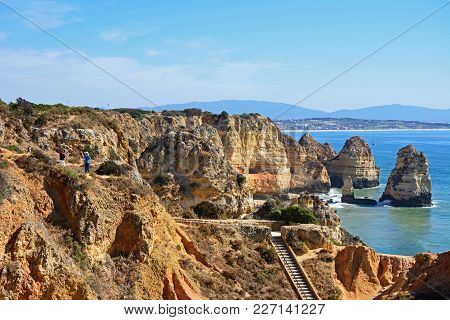 Ponta Da Piedade - June 8 2017 - Elevated View Of The Rugged Coastline With Steps In The Foreground