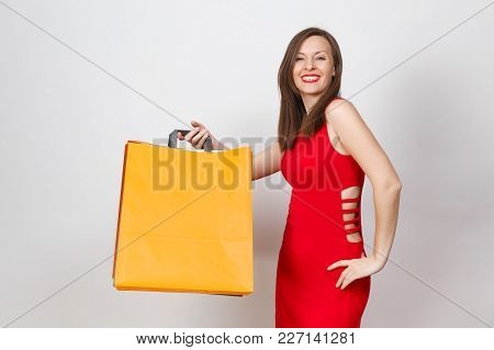 Attractive Glamour Fashionable Young Woman In Red Dress Holding Multi Colored Packets With Purchases