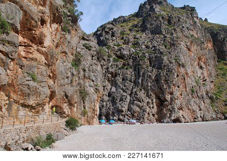 MAJORCA, SPAIN - SEPTEMBER 6, 2017: The Torrent de Pareis river gorge at Sa Calobra on the Spanish island of Majorca. The gorge is one of the top tourist attractions on the island.