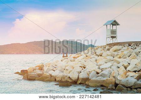 White Safe Guard Stand Over Seacoast Skyline, Natural Landscape Background