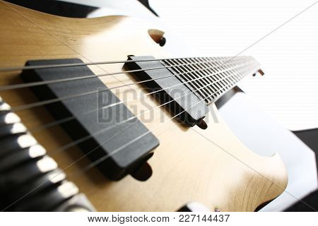 Classic Shape Wooden Electric Guitar With Rosewood Neck Closeup. Six Stringed Learning Lesson Musici