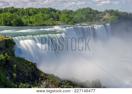 Beautiful Niagara Falls On A Clear Sunny Day. Long Exposure.