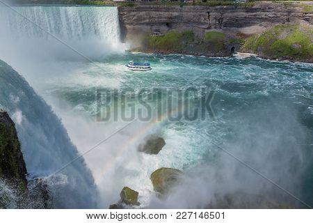 Touristic Boat On Horseshoe Fall, Niagara Falls, Ontario, Canada.