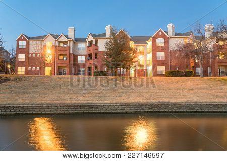 Riverside Apartment Building Complex Reflection At Blue Hour