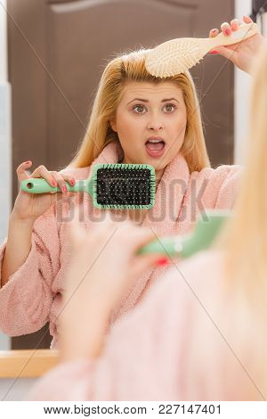 Woman Wearing Dressing Gown Trying To Brush Her Long Blonde Very Tangled Hair, Morning Beauty Routin