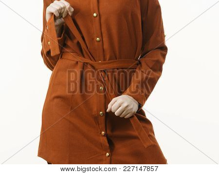 Fashionable Pretty Woman Wearing Elegant Casual Brown Short Dress Presenting Stylish Outfit.