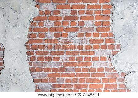 Old Grungy Brick Wall With Concrete Stucco. Loft Decoration